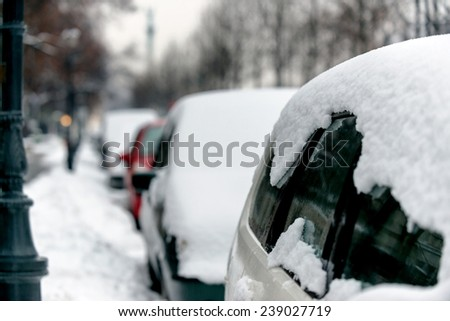 Cars covered in snow after heavy blizzard - stock photo