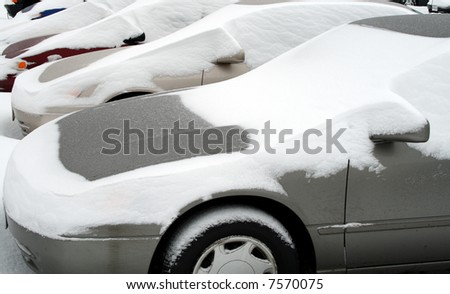 cars covered in snow after snowstorm - stock photo