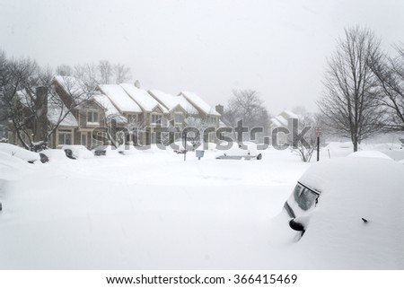 Cars covered in snow during snow Blizzard in Washington DC area. neighborhood houses - stock photo
