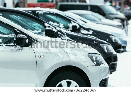 Cars covered with fresh white snow in winter time - stock photo