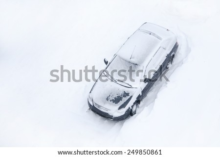 Cars covered with snow, view from above - stock photo