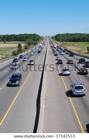 Cars driving on the highway - stock photo
