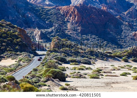 Cars driving on the highway TF-21, leading from the Teide volcano to the south coast of Tenerife. Canary Islands, Spain