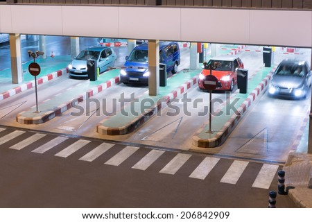 Cars exiting a parking garage at the airport.  - stock photo