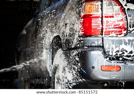 cars in a carwash - stock photo