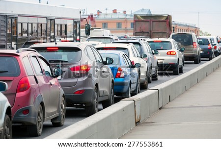 Cars in a traffic jam on the big city street - stock photo