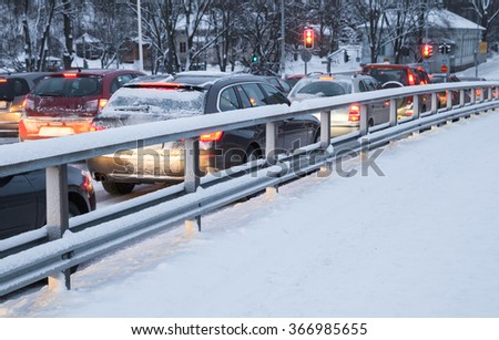 Cars in a traffic jam on winter street in Finland - stock photo