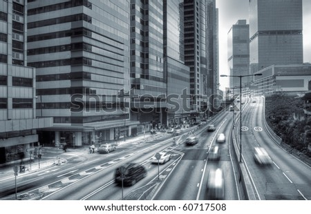 Cars in modern city with motion blurred. - stock photo
