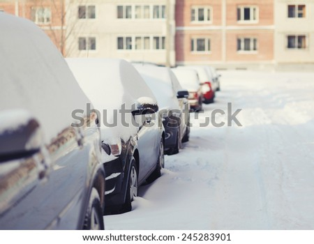 Cars in the snow, cold winter sunny day - stock photo