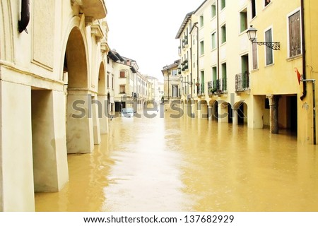 cars in the streets and roads submerged by the mud of the flood after the flooding of the River 3 - stock photo