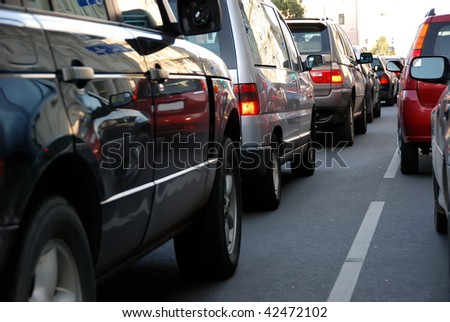 cars in traffic jam in a city during rush hour - stock photo