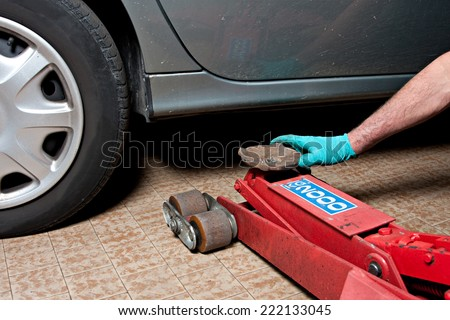cars lifted off the ground to be repaired - stock photo