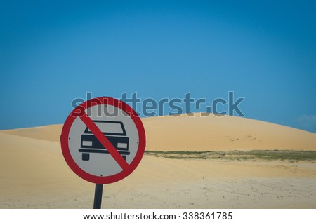 Cars not allowed sign on beach sand - stock photo