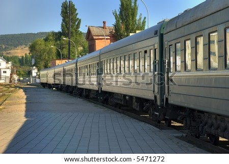 Cars of a passenger train costing at station - stock photo
