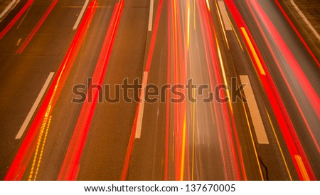 cars on a highway by night   - stock photo