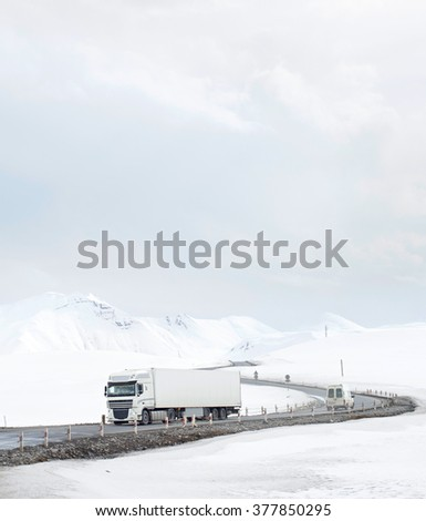 Cars on a mountains road in the winter. Georgian republic - stock photo