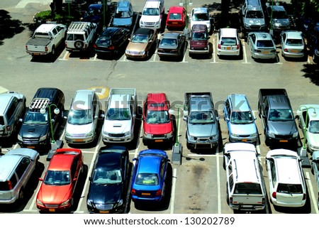 Cars on a parking lot - stock photo