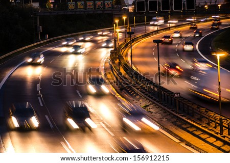 cars on highway by night - stock photo