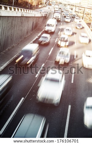 cars on highway in daylight - stock photo