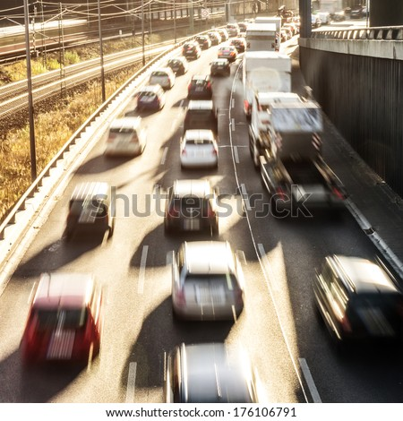 cars on highway in sunlight - stock photo