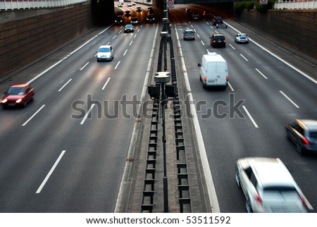 cars on motorway at dawn - stock photo