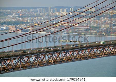 Cars on the bridge of 25th April, Lisbon - stock photo