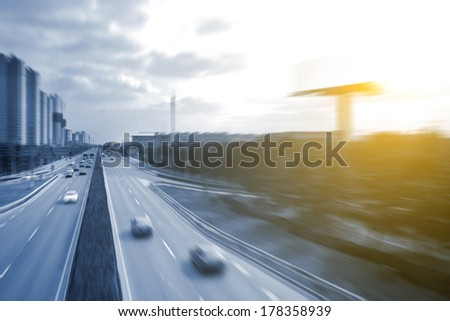 cars on the road with motion blur - stock photo