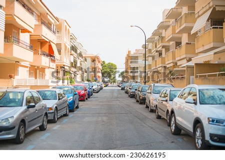 Cars parked along the street. - stock photo