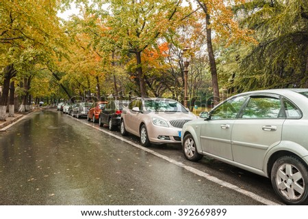 Cars parked along the street - stock photo