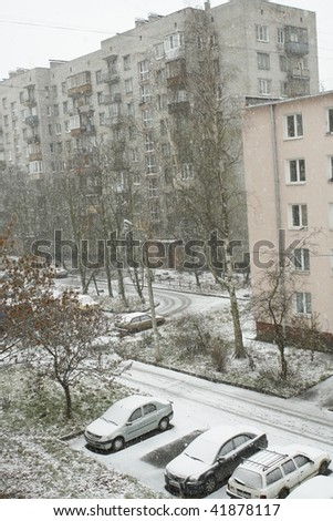 Cars parked  in row in winter yard
