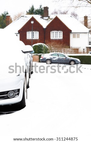 Cars parked in snow - stock photo
