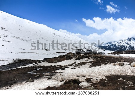 Cars parking among snow mountain at Zero point ,Lachung village,Sikkim.Northern India - stock photo