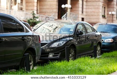 Cars parking near building - stock photo