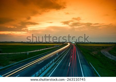 Cars speeding on a highway near city Szeged, Hungary - stock photo