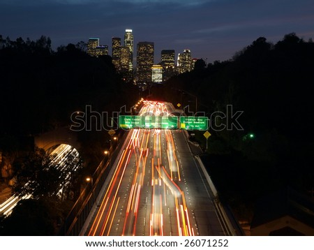 Cars streaking towards downtown Los Angeles on America's oldest freeway. - stock photo