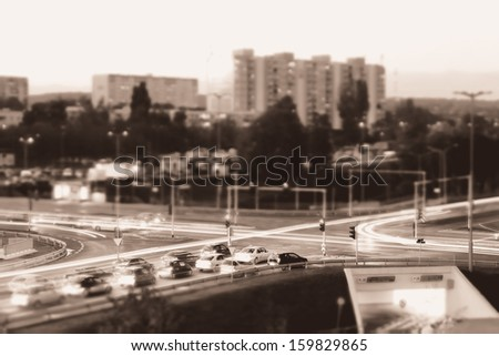 Cars stuck in traffic at an intersection  - stock photo