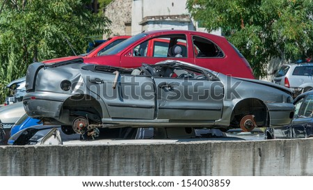 Cars that have finished their lives, are now massed for possible recycling in whole or in part of them. - stock photo