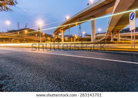 cars through the city at night. - stock photo