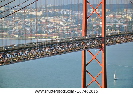 Cars traffic. Bridge of 25th April in Lisbon, Portugal - stock photo