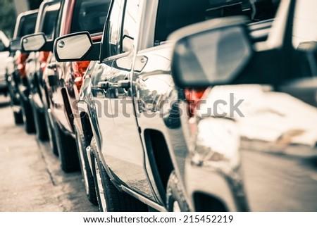 Cars Traffic Closeup. Urban Transportation Concept. Pickup Trucks Line. - stock photo