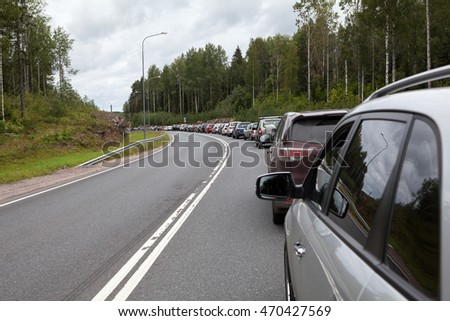 Cars waiting in line to enter the checkpoint Brusnichnoe on the Russian-Finnish border