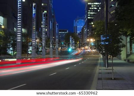 Cars with rear drag light, heading towards downtown Montreal dusk # 2 - stock photo