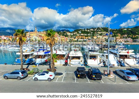 Cars,yachts in the luxury harbor on the Azur coast,Menton,France,Europe - stock photo