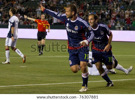 CARSON, CA. - APR 30:  Alejandro Moreno (L) celebrates a goal with Nick LaBrocca (R) during the Chivas USA vs. New England Revolution match on April 30, 2011 at the Home Depot Center in Carson, Ca.