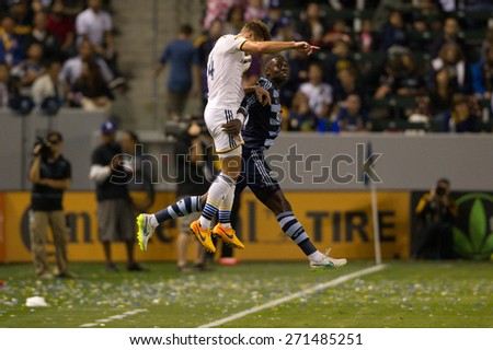 CARSON, CA. - APR 18: Robbie Rogers (L) & Jalil Anibaba in action during the L.A. Galaxy game against Sporting Kansas City on April 18, 2015 at the StubHub Center in Carson, California. - stock photo