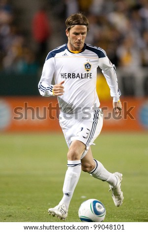 CARSON, CA. - April 23: Los Angeles Galaxy M David Beckham #23 during the MLS game between the Portland Timbers & the Los Angeles Galaxy on April 23 2011 at the Home Depot Center. - stock photo