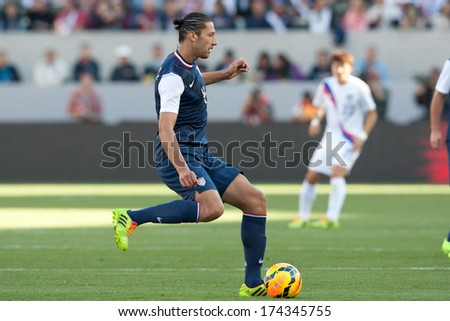 CARSON, CA. - FEB 01: USA D Omar Gonzalez #4 in action during the U.S. mens national team soccer friendly against Korea Republic on Feb 1st 2014 at the StubHub Center in Carson, Ca. - stock photo