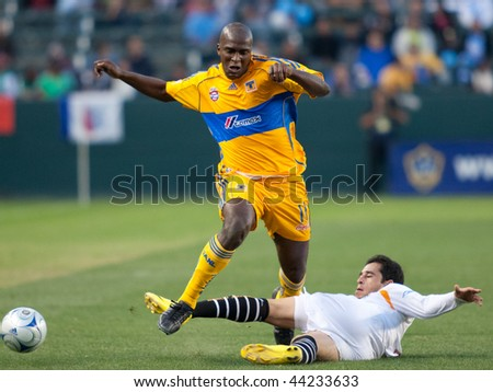 CARSON, CA. - JANUARY 10: Itamar Batista (L) and Oscar Razo (R) in action during the InterLiga 2010 match of Tigres vs. Jaguares at the Home Depot Center on January 10, 2010 in Carson. - stock photo
