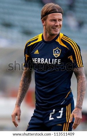 CARSON, CA - MARCH 14: David Beckham warms up before the CONCACAF match between the LA Galaxy and Toronto FC on March 14, 2012 at the Home Depot Center in Carson, Ca. - stock photo