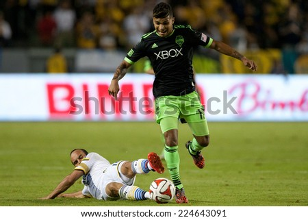 CARSON, CA - OCT 19: Landon Donovan and DeAndre Yedlin (R) in action during the Los Angeles Galaxy MLS game against the Seattle Sounders on October 19th 2014 at the StubHub Center. - stock photo